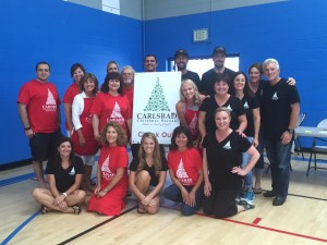 2015 sign up event photo with volunteers and committe